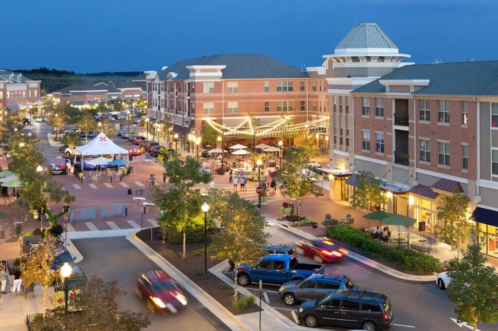 People walk and drive through downtown Loudon in Northern Virginia at dusk